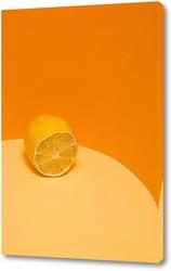Лимон на оранжевом фоне