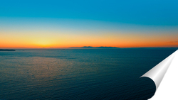 Постер Аэросъемка морского пейзажа на закате.